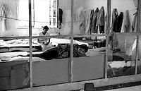 Roma  Giugno 1990.Ex Pastificio Pantanella occupato da centinaia di immigrati asiatici provenienti dal Pakistan e Bangladesh..Rome June 1990.Ex Pastificio Pantanella occupied by hundreds of Asian immigrants from Pakistan and Bangladesh..