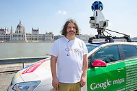 Driver poses with the special car recording photos for the Google Street View service in front of the Hungarian Parliament during a press conference on the Hungarian launch of Google Street View in Budapest, Hungary on April 23, 2013. ATTILA VOLGYI
