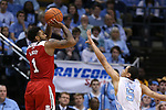 24 February 2015: NC State's Trevor Lacey (1) shoots over North Carolina's Marcus Paige (5). The University of North Carolina Tar Heels played the North Carolina State University Wolfpack in an NCAA Division I Men's basketball game at the Dean E. Smith Center in Chapel Hill, North Carolina. NC State won the game 58-46.