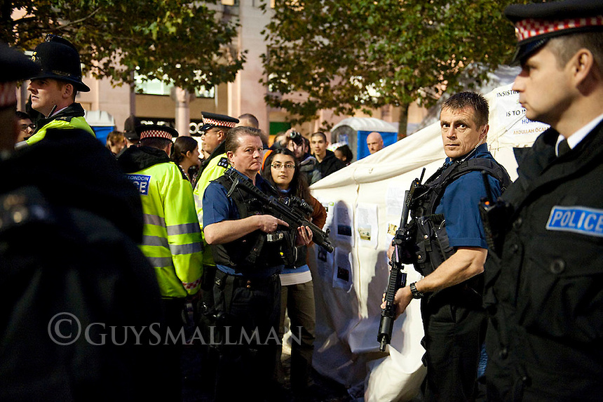 Armed Police raid Kurds at St.Pauls camp 27-10-11 Armed officers search a tent occupied by Kurdish activists at the Occupy London Protest Camp.