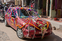 Nepal, Patan.  Car Carrying a Newly-Married Couple.