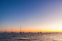 Sailboats at sunset, anchored off the shore of Placencia, Belize