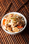Moo Goo Gai Pan - Chicken and mushroom with rice in a bowl.