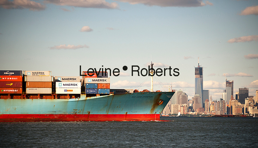 The Maersk line Sea Land Champion laden with containers leaves port in the New York and New Jersey harbor on Sunday, September 23, 2012. The under construction World Trade Center is seen in skyline. (© Richard B. Levine)