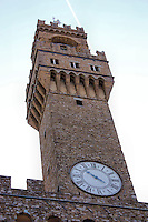 Looking up at the bell tower and clock at Piazza della Signoria in Florence