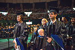 Yearry Pansi Setianto (Left) and Animesh Singh Rathore (rRght) are recognized for earning their PhDs in Mass Communications. Photo by Ben Siegel