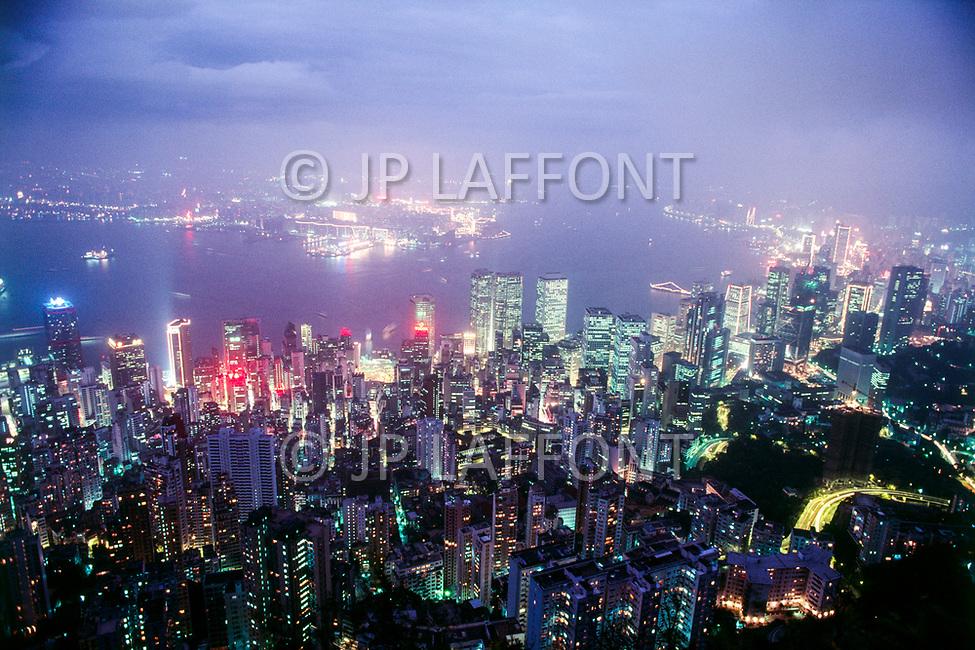 1988, Hong Kong, China --- Aerial View of Hong Kong at Night --- Image by © JP Laffont