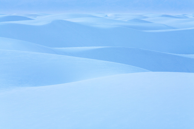 The sand dunes of White Sands National Monument take on a pastel blue hue a few minutes after sunset. Alamogordo, New Mexico.