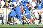 Kentucky's Matt Roark (3) is chased at Commonwealth Stadium in Lexington, Ky. on Saturday, November 5, 2011. ..
