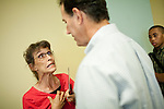 A member of the Tea Party pleads her case to Republican presidential candidate, former Sen. Rick Santorum, at a town hall event in Mount Pleasant, Iowa July 28, 2011.