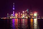 Shanghai city skyline illuminated at night reflecting in Huangpu River. Lujiazui, Pudong, Shanghai, China. Nighttime scenery. 2014