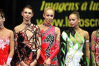 Awards lineup (L-R)...Svetlana Rudalova, Inna Zhukova of Belarus, Marina Shpekt of Russia at 2006 Portimao World Cup of Rhythmic Gymnastics on September 10, 2006 at Portimao, Portugal.  (Photo by Tom Theobald)
