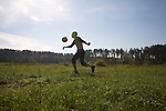 A patient in a rehabilitation program for heroin addiction operated by the NGO Rosa Vetrov plays with a soccer ball in Kazan, Russia, on Wednesday, September 26, 2007. The dozen patients in the free three-month program take a weekly field trip to a nearby lake, where they learn play soccer, have group therapy sessions, and generally learn how to relax and have fun without using drugs.