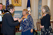 Actor Al Pacino, left, speaks with gospel and blues singer Mavis Staples, center, as the five recipients of the 39th Annual Kennedy Center Honors convene to pose for a group photo following a dinner hosted by United States Secretary of State John F. Kerry in their honor at the U.S. Department of State in Washington, D.C. on Saturday, December 3, 2016.  Argentine pianist Martha Argerich looks on from right.  The 2016 honorees are: Argentine pianist Martha Argerich; rock band the Eagles; screen and stage actor Al Pacino; gospel and blues singer Mavis Staples; and musician James Taylor.<br /> Credit: Ron Sachs / Pool via CNP