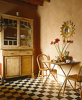 A small quarry-tiled kitchen is only large enough for two people to sit and eat in