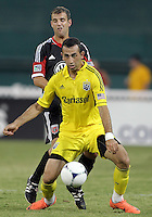 WASHINGTON, DC - AUGUST 4, 2012:  Chris Kolb (22) of DC United blocks Justin Meram (9) of the Columbus Crew during an MLS match at RFK Stadium in Washington DC on August 4. United won 1-0.