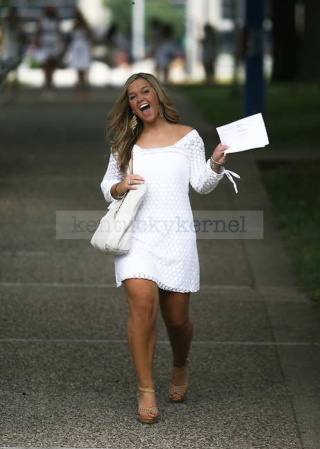 UK sorority rush week participant celebrates after receiving her bid at Memorial Coliseum in Lexington, Ky., on Thursday, August 22, 2013. Photo by Michael Reaves | Staff