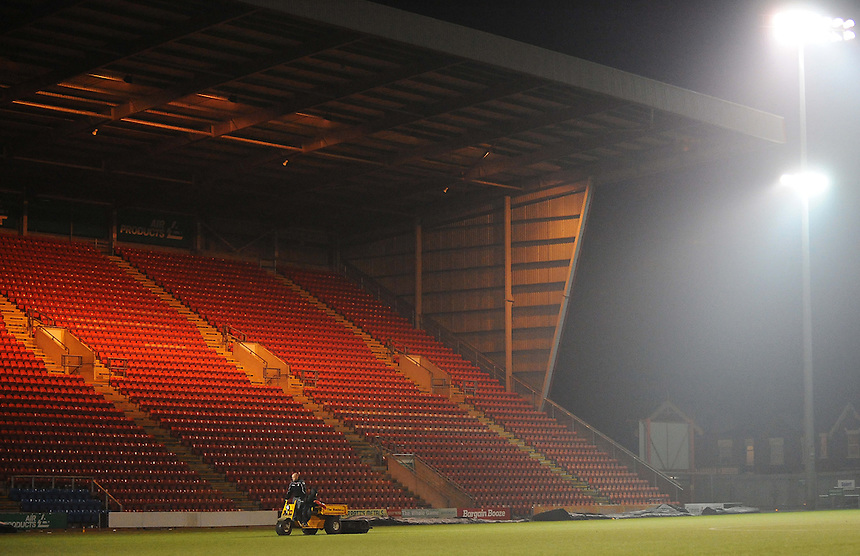 A groundsman rolls the pitch after todays match<br /> <br /> Photographer Kevin Barnes/CameraSport<br /> <br /> Football - The Football League Sky Bet League One - Crewe Alexandra v Preston North End - Sunday 28th December 2014 - Alexandra Stadium - Crewe<br /> <br /> &copy; CameraSport - 43 Linden Ave. Countesthorpe. Leicester. England. LE8 5PG - Tel: +44 (0) 116 277 4147 - admin@camerasport.com - www.camerasport.com