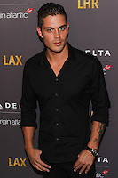 WEST HOLLYWOOD, CA, USA - OCTOBER 22: Max George arrives at the Delta Air Lines And Virgin Atlantic Celebratration Of New Direct Route Between LAX And Heathrow Airports held at The London Hotel on October 22, 2014 in West Hollywood, California, United States. (Photo by Rudy Torres/Celebrity Monitor)