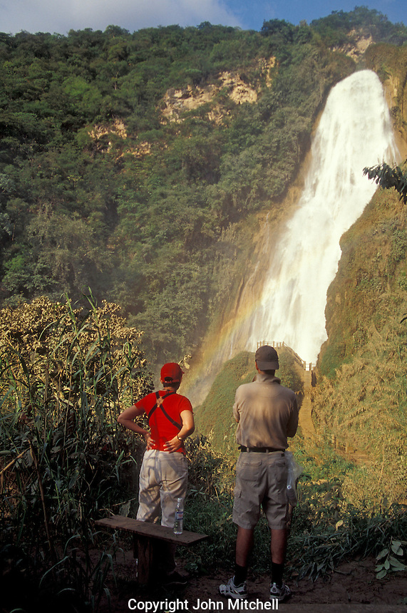 Hikers admiring the 70 metre high Velo de Novia waterwall at El Chiflon near Comitan, Chiapas, Mexico