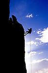 Silhouetted climber rappelling from the summit of Eichorn Pinnacle, Tuolumne Meadows, Yosemite National Park, California USA