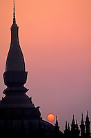 Early morning in Vientiane 1992,the main temple in the city center, and a small bird in the sky