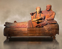 6th century BC Etruscan Sarcophagus known as The Sarcophagus of the Spouses, the in sculpted in clay by the sculptors of Caere, 520-510 BC, Louvre Museum, Paris.  Art Background. To license for non editorial Advertising usage contact The Louvre Paris