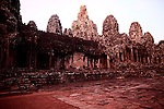 The ruins of Bayon are bathed in red, just after sunrise in Angkor Thom, Cambodia. June 8, 2013.