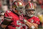 San Francisco 49ers inside linebacker Gerald Hodges (51) and inside linebacker Nick Bellore (50) celebrate tackle on Sunday, October 23, 2016, at Levis Stadium in Santa Clara, California. The Buccaneers defeated the 49ers 34-17.