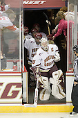Molly Schaus (BC - 30) leads the Eagles onto the ice for Boston College's home opener. - The Boston College Eagles defeated the visiting Brown University Bears 5-2 on Sunday, October 24, 2010, at Conte Forum in Chestnut Hill, Massachusetts.