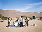 """Touareg Rebels music band, formed by the """"Nigerien Movement for Justice"""" in order to spread their message all over the Sahel Region. During earlier rebelions in the 1990's music groups such as this were formed and became famous through out Europe. Northern Niger. March 2008"""