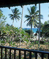 A view from one of the balconies over the palm trees in the garden to the dazzling ocean beyond