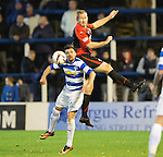 Morton v St Johnstone....30.10.13   Scottish League Cup Quarter Final<br /> Frazer Wright gets above Nacho Novo<br /> Picture by Graeme Hart.<br /> Copyright Perthshire Picture Agency<br /> Tel: 01738 623350  Mobile: 07990 594431