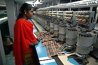 An Indian lady working with a Brudan 920 (9colour 20 heads) at Popy's embroidery making factory in Tirupur, Tamilnadu. After lifting of quota system in textile export on 1st january 2005. Tirupur has become the biggest foreign currency earning town of India.
