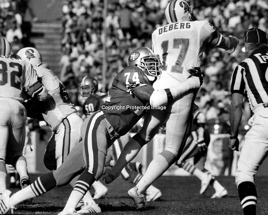 San Francisco 49er defensive end Fred Dean putting the rush on Tampa Bay Steve DeBerg 1984 Action..(photo by Ron Riesterer)
