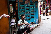 A foreigner tries the Indian perfume at the Itr (indian perfume) shop in the ancient city of Varanasi in Uttar Pradesh, India. Photograph: Sanjit Das/Panos