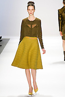 Suzie Bird walks the runway in a Luca Luca Fall 2011 outfit, designed by Raul Melgoza, during Mercedez-Benz Fashion Week, February 10, 2011