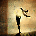 Silhouette of an illuminated woman. Photo based illustration.