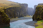 A river winds through the gorge at Fja&eth;raglj&uacute;fur, near Laki in southern Iceland.