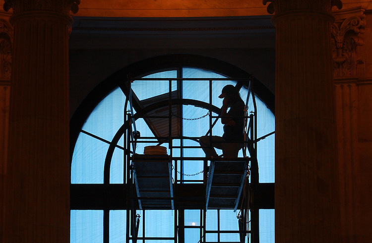 George Grello of Corning Construction in Maryland, takes a break from replacing windows on the third floor of the Russell Rotunda.  All three window units will be replaced by the fall.  Records show that 1973 may have been the last time the windows were serviced.