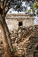 Watchtower and stone wall, at the Mayan ruins of Tulum on the Riviera Maya, Quintana Roo, Mexico.