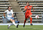 24 September 2006: UNC's Heather O'Reilly (20) shoots past Miami's Meghan McKinsey (11) and scores a goal at 51:21. The University of North Carolina Tarheels defeated the University of Miami Hurricanes 6-1 at Fetzer Field in Chapel Hill, North Carolina in an NCAA Division I women's soccer game.