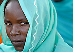 A woman in the Habile Camp for internally displaced Chadians outside the village of Koukou Angarana. Some 25,000 people live in precarious conditions in this camp. More than 180,000 residents of eastern Chad have been displaced by violence spilling over from neighboring Darfur, inter-ethnic conflict, and fighting between rebels and the Chadian government.