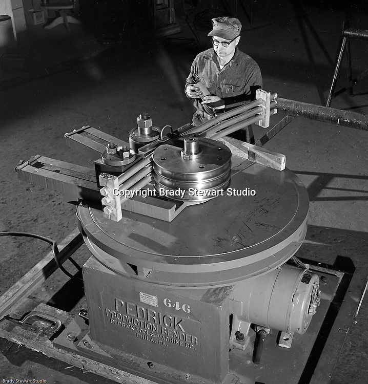 Client: The Pittsburgh Piping Company<br /> Ad Agency:<br /> Product: Fabricated Steel Pipe<br /> Location: On location<br /> <br /> View of operator bending pipe with the new Pedrick Production Bender machine.  The manufacturer is the Pedrick Tool &amp; Machine Company of Philadelphia Pennsylvania.