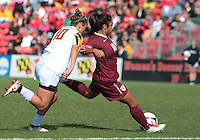 COLLEGE PARK, MD - OCTOBER 21, 2012:  Riley Barger (10) of the University of Maryland tries to stop a shot by Hikaru Murakami (18) of Florida State during an ACC women's match at Ludwig Field in College Park, MD. on October 21. Florida won 1-0.