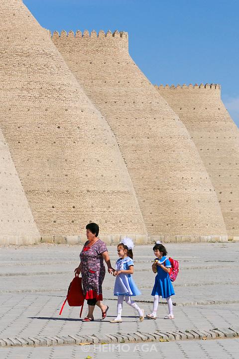 Uzbekistan, Bukhara.<br /> The Ark. School girls with mother.