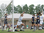 Duke's Elisabeth Redmond (16) and Darby Kroyer (7) celebrate as teammate Christie McDonald's (not picture) shot squeaks past Marquette's Laura Boyer (below) and into the goal in the sixth minute on Sunday September 17th, 2006 at Koskinen Stadium on the campus of the Duke University in Durham, North Carolina. The Duke Blue Devils and Marquette Golden Eagles tied 1-1 after overtime in an NCAA Division I Women's Soccer game.