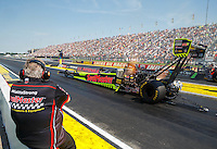 Sep 5, 2016; Clermont, IN, USA; Team owner Connie Kalitta watches NHRA top fuel driver J.R. Todd during the US Nationals at Lucas Oil Raceway. Mandatory Credit: Mark J. Rebilas-USA TODAY Sports
