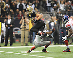 New Orleans Saints Jimmy Graham (80) vs. New York Giants Deon Grant (34) at the Superdome in New Orleans, La. on Monday, November 28, 2011. New Orleans won 49-24.