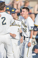 Michigan Wolverines designated hitter Nick Poirier (28) greets teammate Jonathan Engelmann (2) after he hit a home run during the NCAA baseball game against the Eastern Michigan Eagles on May 16, 2017 at Ray Fisher Stadium in Ann Arbor, Michigan. Michigan defeated Eastern Michigan 12-4. (Andrew Woolley/Four Seam Images)